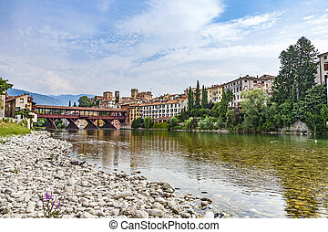 the old wooden bridge spans the river brenta at the village Basano del Grappa