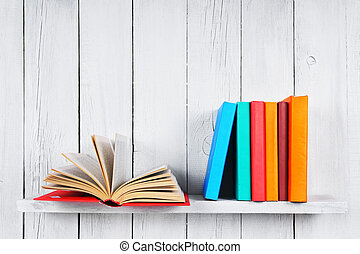 The open book and other multi-coloured books.
