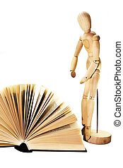 open book and wooden dummy