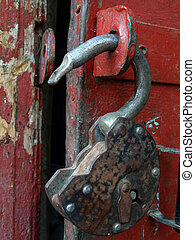 The open lock - The open  old, rusty hinged lock. A close up