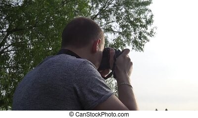 the operator takes photos of nature on camera.
