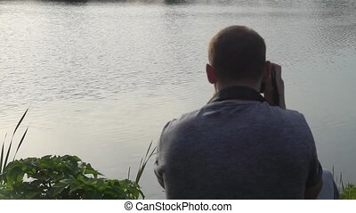 the operator takes photos of nature on camera