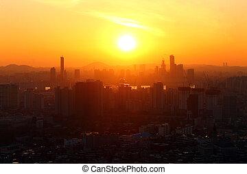 The orange sunset over the city of Seoul