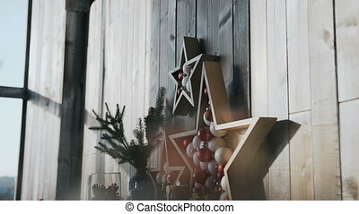 The original decor in the form of a wooden star hangs on the wooden wall of the cozy room