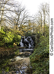 The Ornamental Cascade waterfall in Virginia Water, Surrey,...