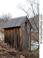 The Outhouse - An old rickety outhouse in rural countryside.