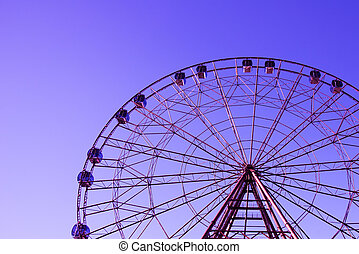 The outline of the Ferris wheel against the sky is a beautiful color.