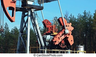Extraction of petroleum by Pumpjack on an oil well in Russia