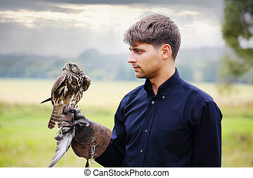 The owner feeds falcon