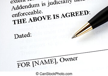The owner signs the legal document with a pen