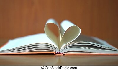 The pages of the book create a heart