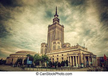 The Palace of Culture and Science, one of the symbols of Warsaw, Poland. Retro, vintage style. Palac Kultury i Nauki