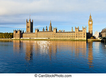 The Palace of Westminster with Elizabeth Tower viewed from across the River Thames