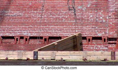 The pallet of bricks for swinging