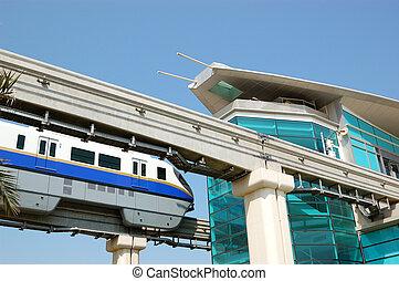 The Palm Jumeirah monorail station and train, Dubai, UAE -...