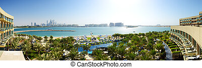 The panorama of beach at modern luxury hotel on Palm...