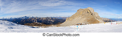 The panorama of ski slope and skiers at Passo Groste ski area, Madonna di Campiglio, Italy