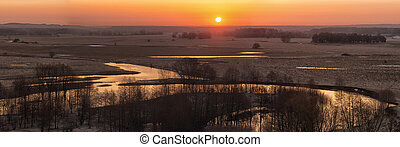 The panorama of sunrise on the river.