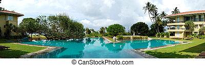 The panorama of swimming pool at luxury hotel, Bentota, Sri...