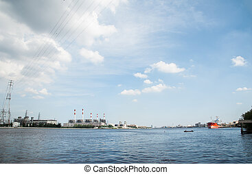 The panoramic view of the electric refinery plant and big red logistic ship in Chao Praya river