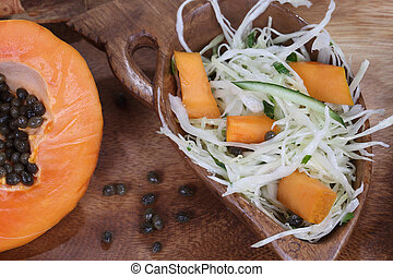 the Papaya salad and vegetables in a wooden bowl