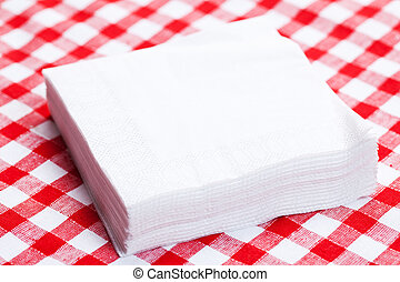 the paper napkins on picnic tablecloth