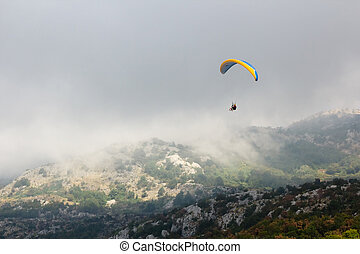 The Paraglide silhouette over mountain peaks. Montenegro