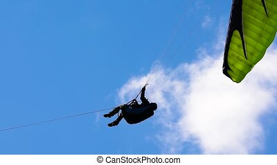 The paraglider takes off on the winch in the field. Extreme...