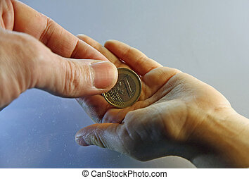 the parent's hand delivering a gratuity to the young son - ...