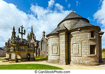 The parish of Guimiliau dedicated to St. Milio and dating 16-17 century. Brittany, France. Spring view.