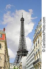 The Parisian street against Eiffel Tower in Paris. France
