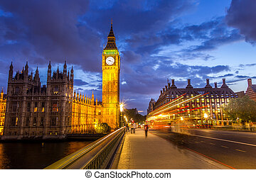 The Parliament, the Big Ben and the Westminster bridge at night, London, England