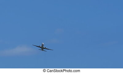 The Passenger Airplane is Flying Far in the Blue Sky - The...