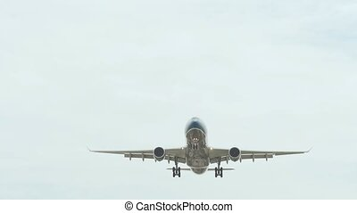 The passenger airplane lands in cloudy weather. - The...