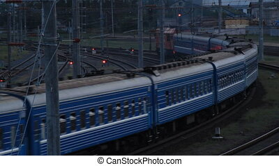 The passenger train passes a turn on the railway