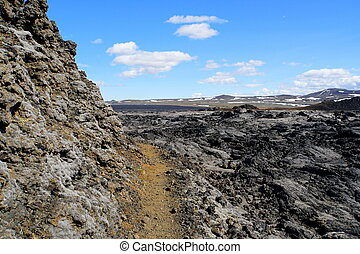 The path on the remnants of the last volcanic eruptions between the year of 1975 and 1984 at Krafla Lava Field near Myvatn, Iceland during the summer