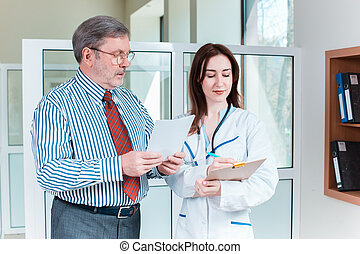 The patient and his doctor in medical office