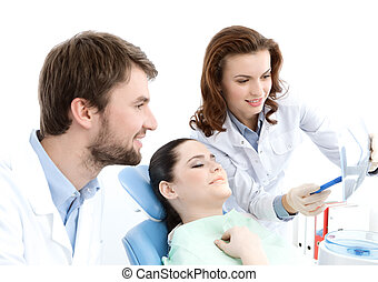 The patient examines the x ray photo of the teeth