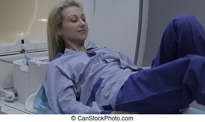 The patient gets up after examining the magnetic resonance...