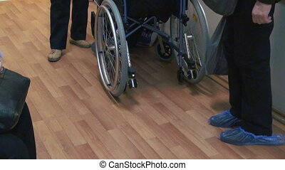 The patient in a wheelchair in the clinic