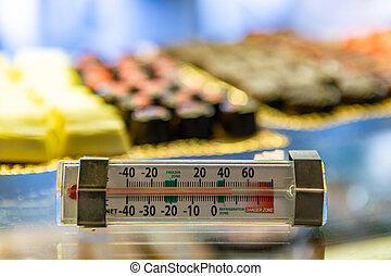 the patisserie refrigerator thermometer. - selective focus ...