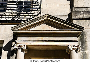 The pediment of a doorway on Brock Street, Bath with engaged Ionic columns
