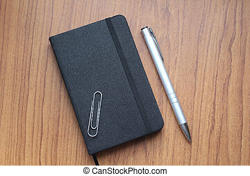 The pen with a notebook for records in business