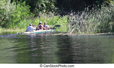 The People goes on a boat, a kayak on the river.