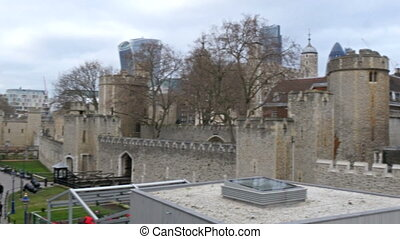 The people walking around the Tower of London