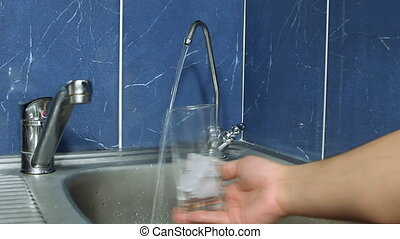 The person pours water from the fil