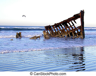 The Peter Iredale, an historic shipwreck on the beach at...