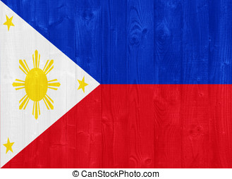 The Philippines flag painted on a wood plank texture