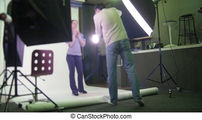 The photographer behind work: woman is photographed in studio.
