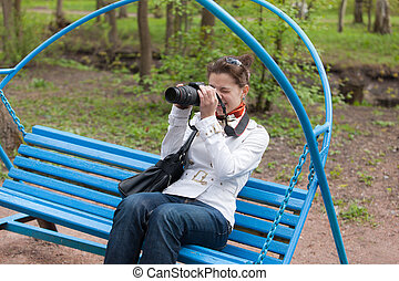 the photographer on a bench